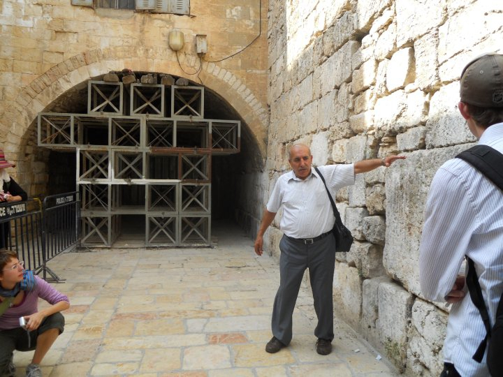 Dr. Nazmi El Jubeh showing students a portion of the Western Wall